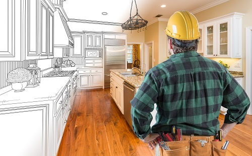 Contractor Looking at a Drawing Photo of Kitchen