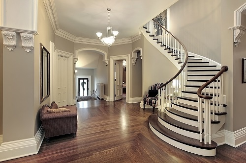 Inside Luxurious Home with Foyer and Curved Staircase