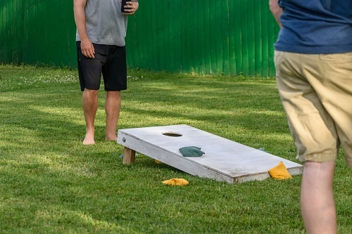 Friends playing cornhole
