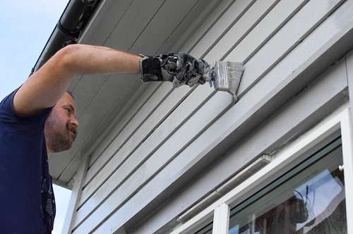 Man Painting House Exterior Gray